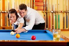 couple playing billiard expertise teacher - stock photo