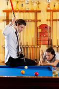 Stock Photo of couple playing billiard expertise teacher