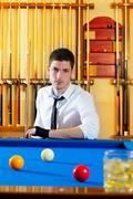 Stock Photo of Billiard expertise man posing on blue