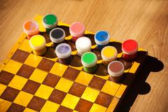 Colourful watercolor paint on the chessboard Stock Photos