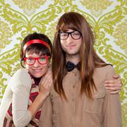 Funny humor nerd couple on vintage wallpaper - stock photo