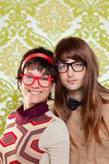 Funny humor nerd couple on vintage wallpaper - stock photo