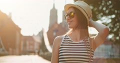 Beautiful Young Woman smiling in European city, cinematic portrait. Slow Motion. Stock Footage