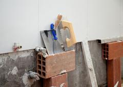 Construction tools notched trowel ans spatula Stock Photos