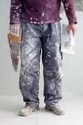 Stock Photo of construction plaster plaster man dirty trousers
