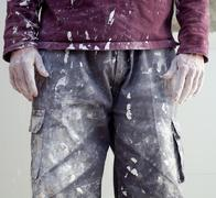 hands dirty trousers of plastering painter man - stock photo