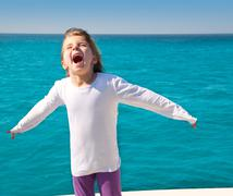 Excited kid girl sailing in a boat open arms Stock Photos