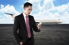 Young business man calling by phone when walking to the plane Stock Photos