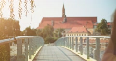 Travelling happy woman walking in the European city. Slow Motion. Lens flare. Stock Footage
