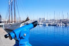 Barcelona port marina with blue telescope - stock photo
