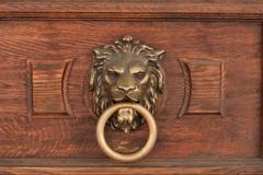Bas-relief of a lion's head with a ring in its mouth Stock Photos