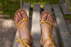 female feet in sandals - stock photo