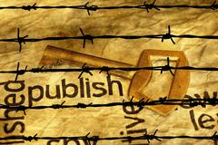 Publish and golden key against barbwire - stock photo