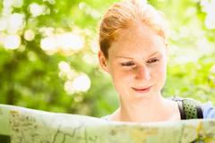 Hiker Navigating by Map in a Forest Stock Photos