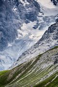 Mountaintop with Snow by Summer - stock photo