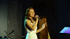 Female singer sings on stage Stock Footage