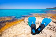 Balearic Formentera island with scuba diving fins - stock photo
