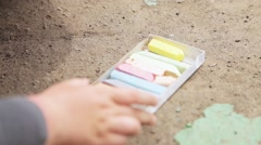 children draw with chalk on the pavement a terrible drawings - stock footage