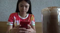 4K Hd Ultra, Asian woman enjoy using smartphone and drinking coffee in bar -Dan - stock footage