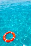 Buoy orange floating in perfect tropical beach Stock Photos
