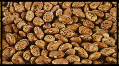 Mix of dried beans background scale and rotation on split screen Stock Footage