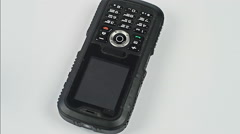 Old mobile phone isolated and rotates on a white background Stock Footage