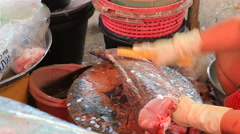 Fish seller in fresh market Stock Footage