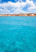 Cala Saona beach in formentera with fishes - stock photo