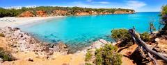 Cala Llenya in Ibiza with turquoise water in Balearic - stock photo