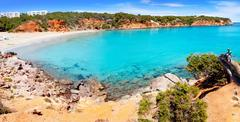 Stock Photo of Cala Llenya in Ibiza with turquoise water in Balearic