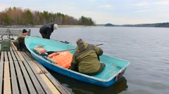 Fishermen and hunters equip the boat rowing. Stock Footage