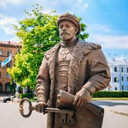 Statue of the Mayor with the key and a royal charter in the hand Stock Photos