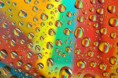 Water drops on multicolor background Stock Photos