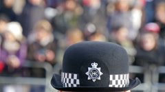 Closer look of the cap of the police officer - stock footage