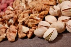 Heap of assorted nuts - stock photo