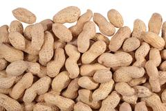 Heap of whole peanuts on a white - stock photo