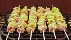 BBQ barbecuing skewers, grill with vegetable skewer - close up. - stock footage
