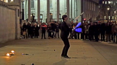 A street juggler giving entertainment to the people Stock Footage