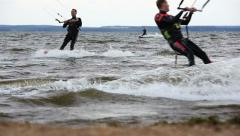 Kite Surfers on the Beach on a Windy Day - stock footage