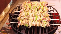 BBQ barbecuing skewers, grill with vegetable skewer - close up. Stock Footage