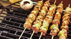 BBQ barbecuing skewers, grill with vegetable skewer and mushrooms. Stock Footage
