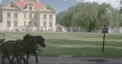The Palmse house in Estonia with the man in the carriage Stock Footage