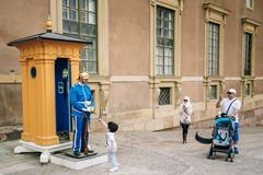 Tourists visit and photograph the guard of honor at the Royal pa - stock photo