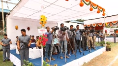 Video graphers at press conference Stock Footage