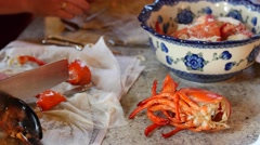 People crack open lobster for dinner Stock Footage