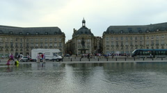 France - Bordeaux - Two Children Running Through Reflecting Pool in Bordeaux Stock Footage