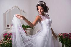 Young beautiful bride in white dress in antique interior - stock photo