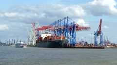 TL 4K Busy Port of Hamburg Cargo Container ship freight at HHLA terminal loading Stock Footage