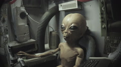 Grey Alien Seated In Control Chair- Area 51- Roswell NM Stock Footage