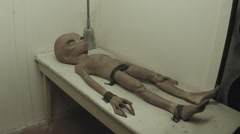Grey Alien Corpse On Medical Examination Table- Side Angle Stock Footage
